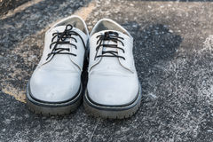 White shoes on concrete Stock Photography