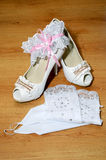 White shoes gloves and a garter Royalty Free Stock Images