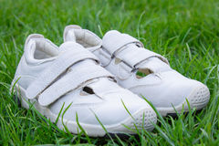 White shoes on the grass Royalty Free Stock Photos