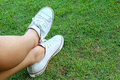 White shoes on a green grass background. Royalty Free Stock Photos