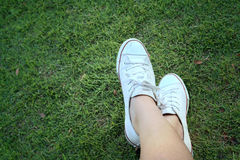 White shoes on a green grass background. Stock Photo