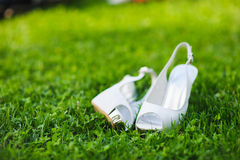 White shoes on green grass Royalty Free Stock Image