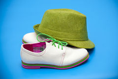 White shoes and green hat Royalty Free Stock Image