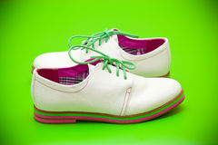 White shoes with green shoelaces Stock Photos