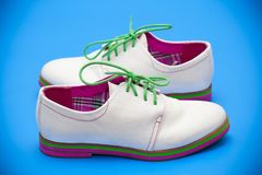 White shoes with green shoelaces Royalty Free Stock Photography