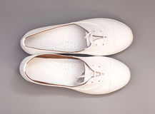 White Shoes isolated Stock Images