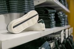 White shoes in a shop. A pair of white shoes on a shop royalty free stock photos