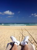 White shoes on the tropical beach Royalty Free Stock Photography