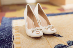 White Shoes with Wedding Rings Royalty Free Stock Image