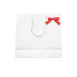 White shopping bag and bow  on white background Stock Photography