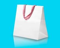 White shopping bag on light blue. Stock Photography