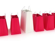 White shopping bag in a row of crimson bags. White classic shopping bag in a row of crimson bags with handles  on white. (3d render Royalty Free Stock Images