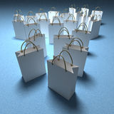 White shopping bags on a blue background Stock Photos