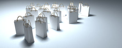 White shopping bags in a pool of light Stock Image