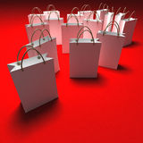 White shopping bags on a red background Stock Photos