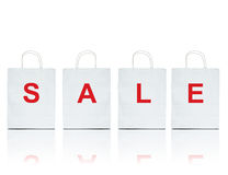 White shopping bags with the word sale Stock Images