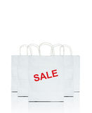 White shopping bags with the word sale Royalty Free Stock Image