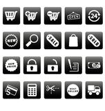 White shopping icons on black squares Royalty Free Stock Images