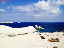White shores and blue ocean. View of beautiful deep blue ocean with rocky white shores Royalty Free Stock Photography