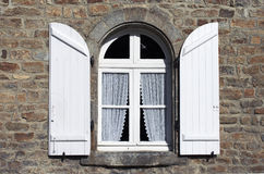 White shutters window at Brita. A tipycal Bretany window with withe curatins Royalty Free Stock Image