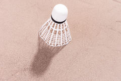 White shuttlecock in the sand. At the beach Royalty Free Stock Image