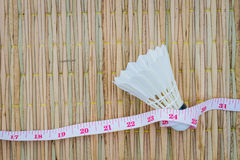 White shuttlecock on traditional mat with measuring tape, diet a stock image