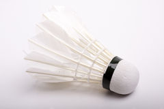 White shuttlecock on white-gray background Royalty Free Stock Images