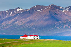 White Siding House with Red Roof at coastline in North Iceland Royalty Free Stock Image