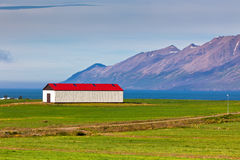 White Siding Icelandic House with Red Roof Royalty Free Stock Images