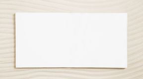 White sign on a beige sand background. Royalty Free Stock Photography