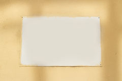 White Sign Board on Wall Stock Photo