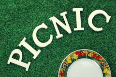 White Sign Picnic On The Lawn And Plates Royalty Free Stock Image