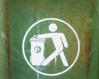 White sign on used green garbage bin Royalty Free Stock Photo