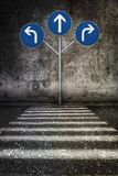 White sign way different directions at grunge wall Stock Images
