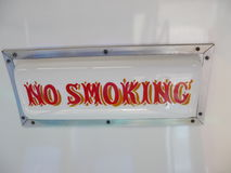 White sign which says not to smoke Royalty Free Stock Image