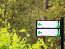 Empty white signboard for cyclists with iron post and defocused background. White signboard for cyclists with iron post and defocused background stock photography