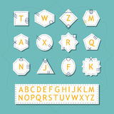 White silhouette basic alphabetical and initial basic shapes labels and stickers set. On trendy blue background Stock Photos