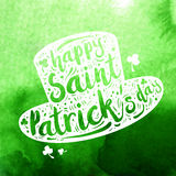White silhouette Patrick hat on green watercolor background. Calligraphy Happy St. Patrick`s day, design element, icon Royalty Free Stock Image