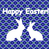 White silhouette of two Easter bunny rabbits. Desi Stock Photo