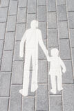 White silhouette walking adult and child on tile Royalty Free Stock Image