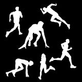 White silhouettes of athletes that run on a black background royalty free illustration