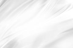 White silk. Closeup of rippled white silk fabric royalty free stock photos