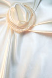 White silk with pearls as wedding background Royalty Free Stock Images