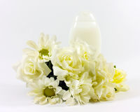 lotion and flowers Stock Images