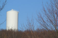 White Silo. A white grain silo in a field stock photo