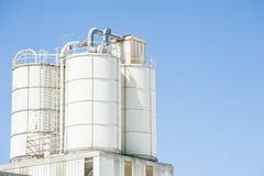 White silos for lime Stock Photo