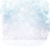 White and silver abstract bokeh lights. defocused background with snowflake overlay Royalty Free Stock Images