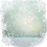 White and silver abstract bokeh lights. defocused background with snowflake overlay.  Royalty Free Stock Images
