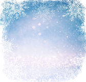 White and silver abstract bokeh lights. defocused background with snowflake overlay Stock Image