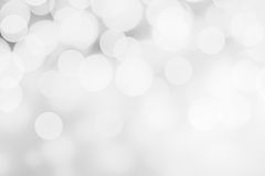 White and silver abstract bokeh lights. Sparkling Christmas defo. Cused background Stock Images